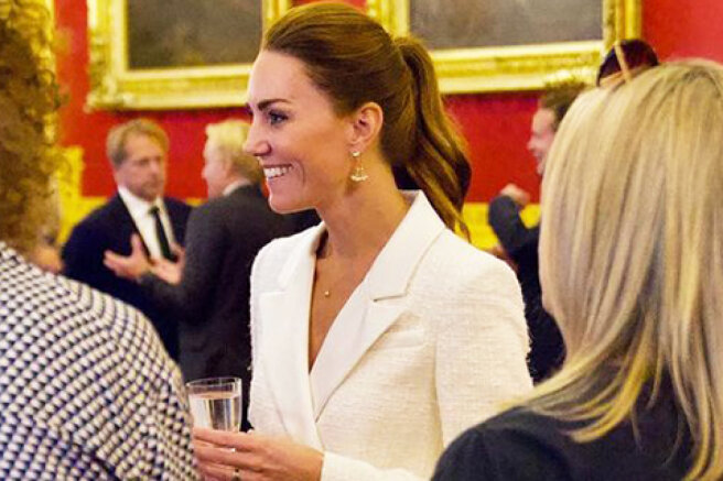 All in white: Kate Middleton at the presentation of her new photo project