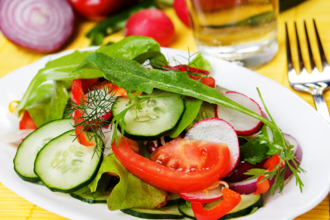 Radish, avocado, tomato and cucumber salad