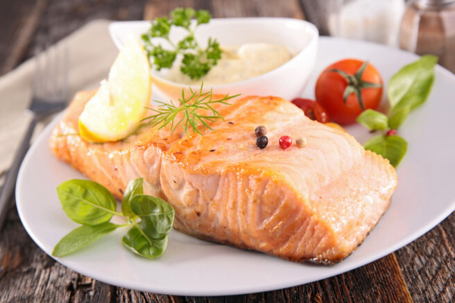 Baked salmon with basil and olive oil